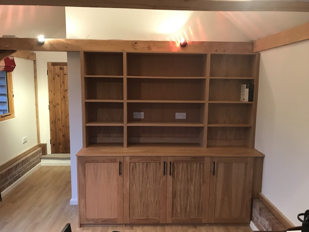 Oak Bookcase & Worktop designed around a beam and odd shaped wall